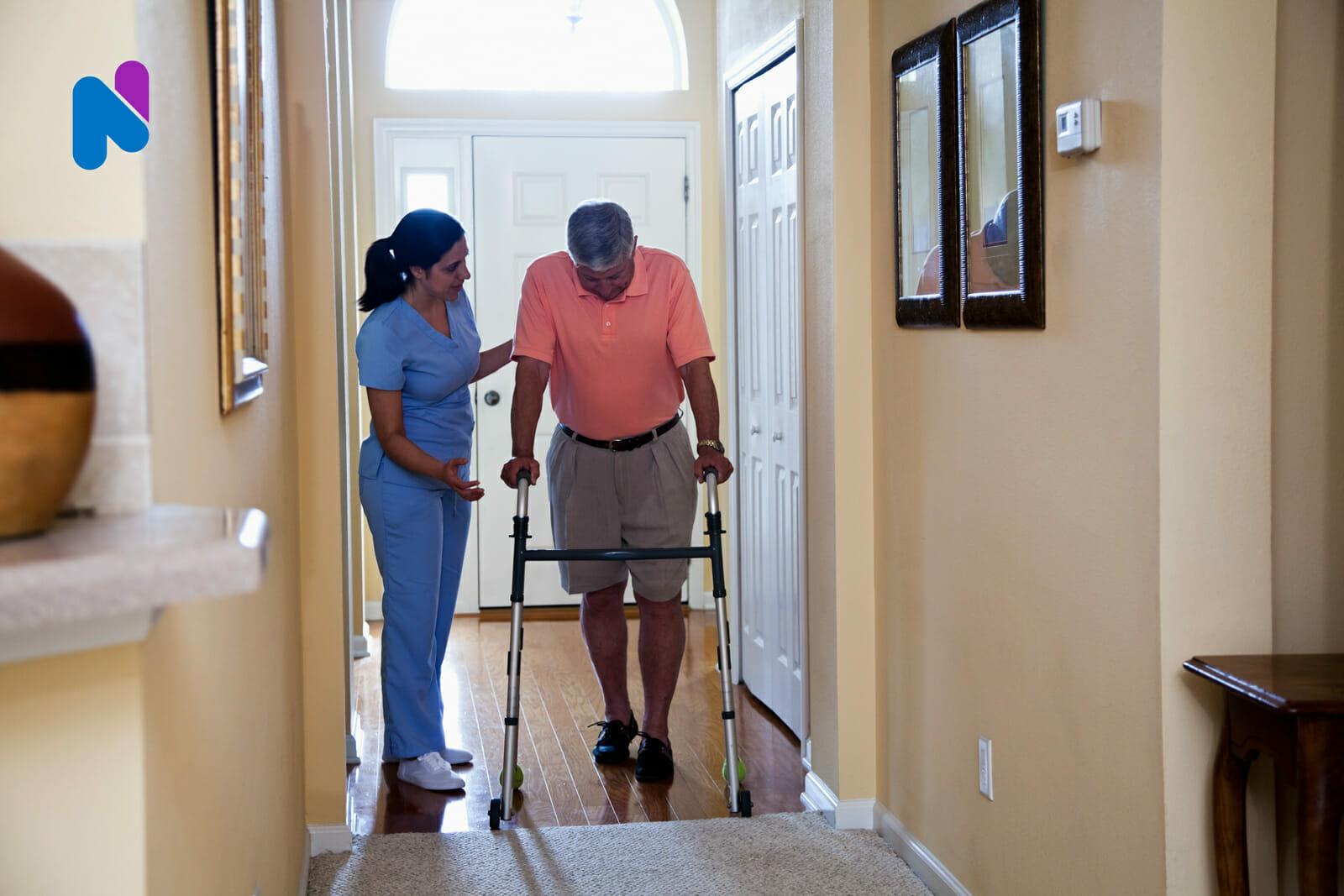 nurse-helping-man-at-home