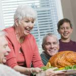 Senior woman serving roasted turkey