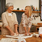 senior mom and daughter doing heart healthy holiday cooking for loved ones with congestive heart failure