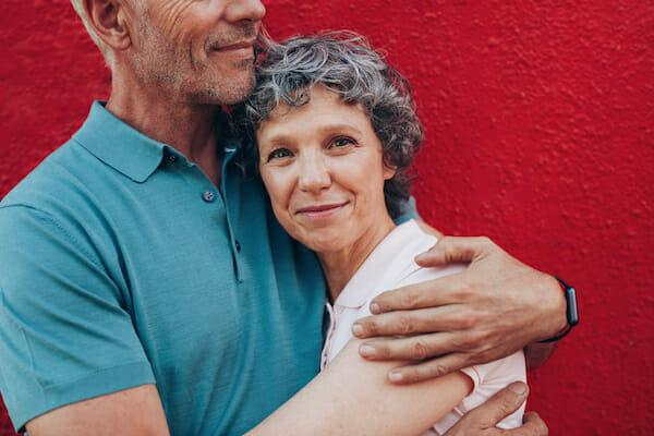 happy-older-woman-hugging-husband