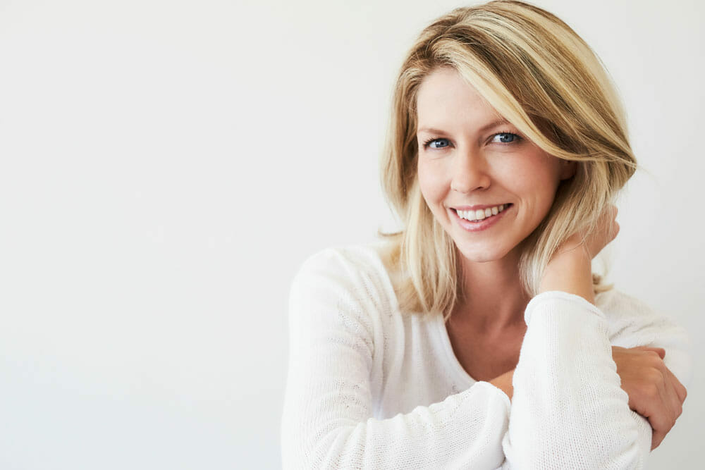 blonde middle aged lady smiling