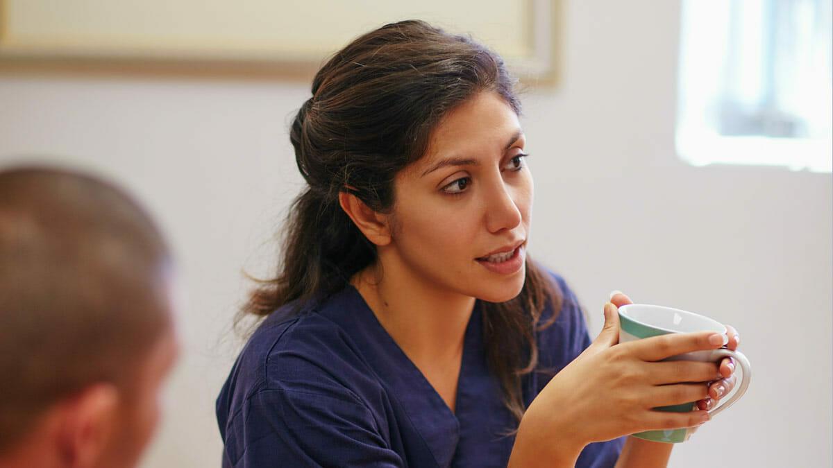 nurse holding coffee mug