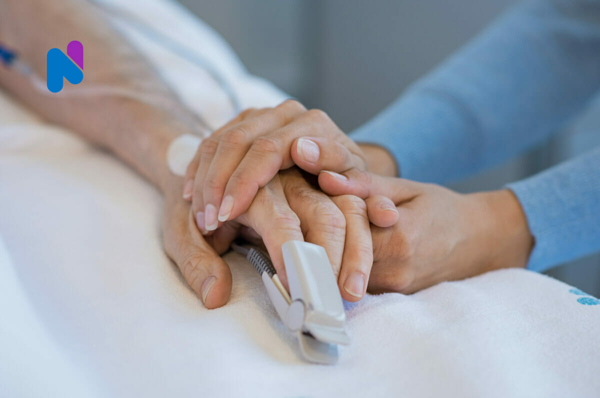 Patient holding hands with medical professional