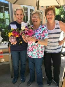 volunteers of random acts of flowers handing out flower donations at avenidas