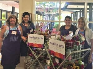 volunteers getting flower donations together to go to webster house