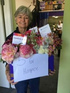 volunteer gathering flower donations ready for mission hospice in san mateo