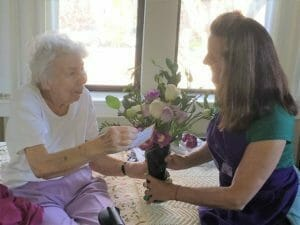 volunteer and flower recipient at webster house