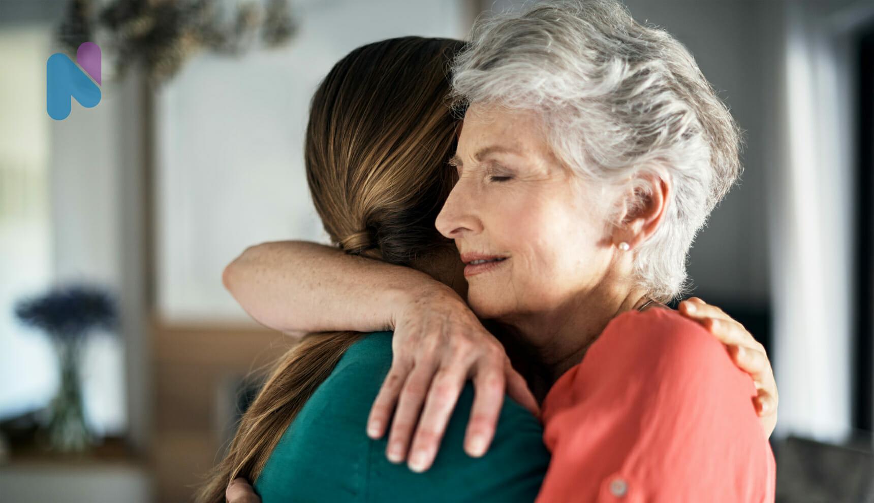 older-woman-hugging-daughter-in-pain