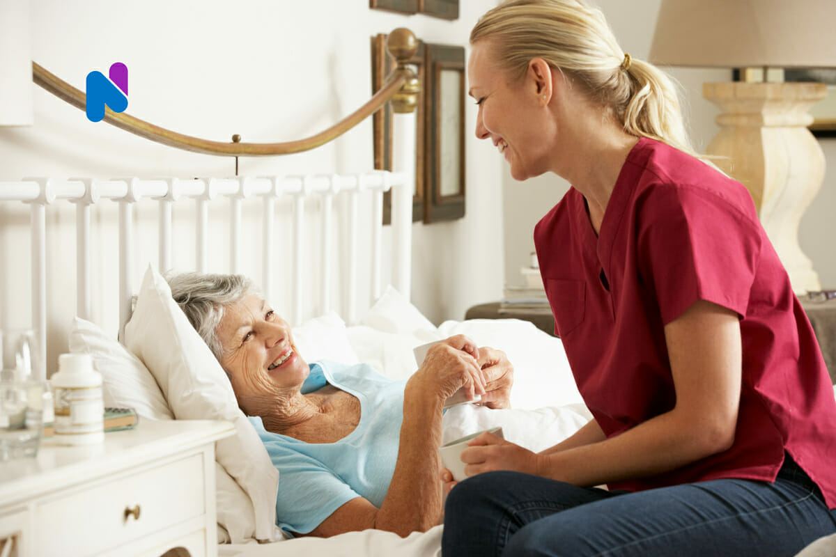 palliative-care-nurse-with-patient-in-bed