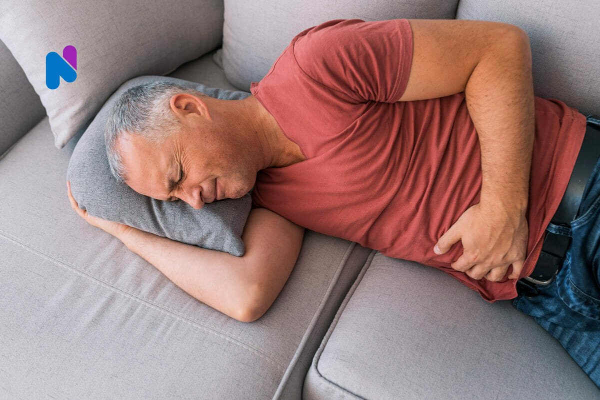 man-holding-stomach-in-pain