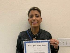Freshta Azami Nurse holding certificate