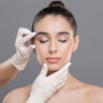 plastic surgery women's face examined for facial wrinkles