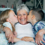 grandmother at home with grandchildren