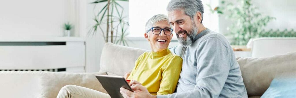 online orders older couple ordering sitting on sofa online