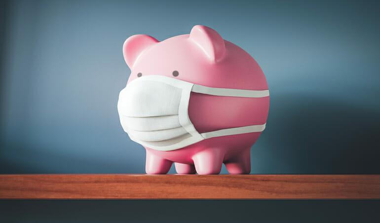 piggy bank wearing mask