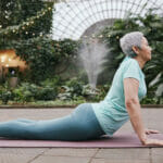 Older woman doing stretches outdoors
